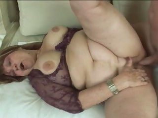 Granny with huge saggy tits masturbates and gets fucked by young man