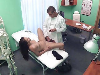 Doctor Examines Patient with Cock