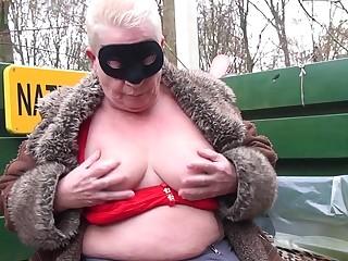 Naughty mature naturist playing outside