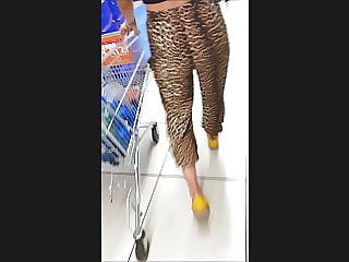 Girl candid ass in leopard style half-shorts