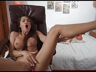 Sexy brunette fingers her shaved pussy with vibe in.
